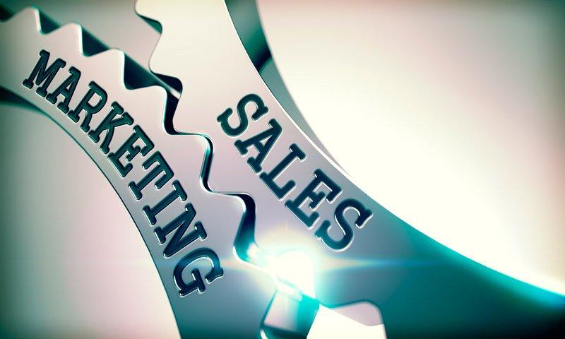 marketing y ventas representadas por la unión de dos engranajes